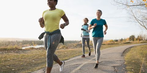 Three women running outside