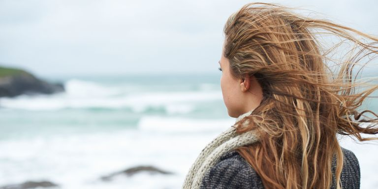Woman looking out to sea back of head