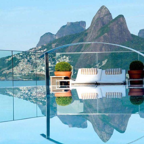 Water, Natural landscape, Reflection, Design, Tourism, Landscape, Lake, Bay, Coastal and oceanic landforms, Leisure,