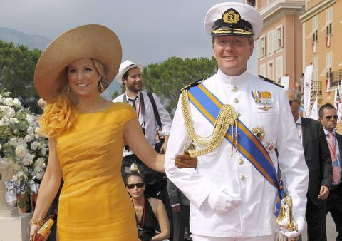 Arm, Smile, Cap, Hat, Dress, Happy, Facial expression, Fashion accessory, Headgear, Costume accessory,