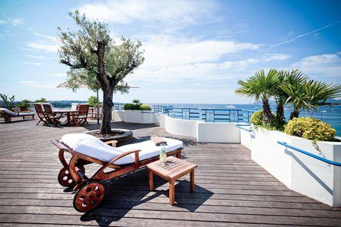 Sky, Cloud, Outdoor furniture, Furniture, Resort, Street furniture, Sunlounger, Hardwood, Tropics, Shade,