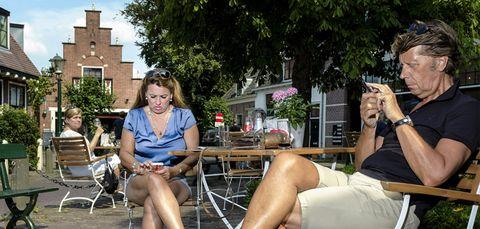 Arm, Leg, Human body, Sitting, Furniture, Summer, Leisure, Outdoor furniture, Fashion accessory, Chair,