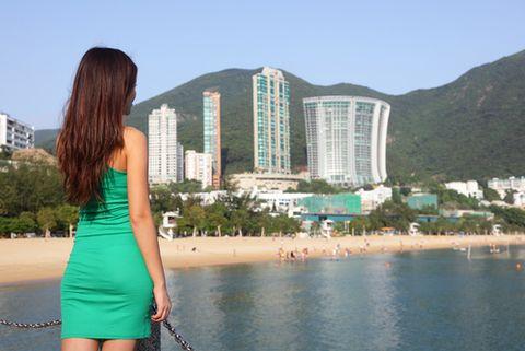 Body of water, Coastal and oceanic landforms, Shoulder, Coast, Shore, Tourism, Building, Condominium, Summer, Waist,