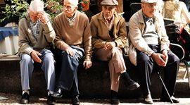 Leg, People, Sitting, Social group, Photograph, Community, Hat, Headgear, Temple, Lap,