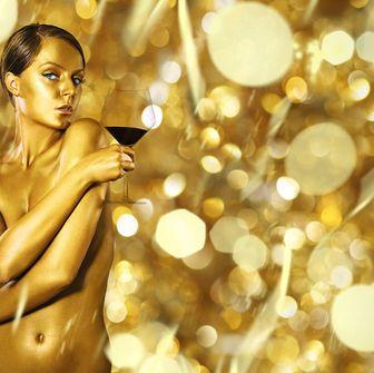 Nose, Amber, Tan, Abdomen, Body jewelry, Perfume, Model,