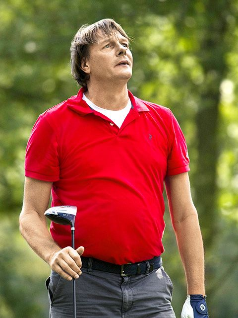 Red, Golf, Recreation, Golfer, Sleeve, Polo shirt, Muscle, Photography, T-shirt,