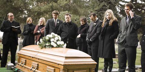 People, Trousers, Coat, Suit, Formal wear, Bouquet, Coffin, Ceremony, Blazer, Suit trousers,