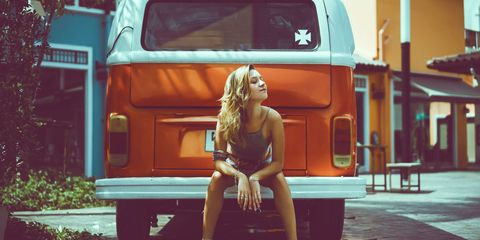 Motor vehicle, Automotive exterior, Vehicle door, Fender, Automotive lighting, Automotive tail & brake light, Bumper, Automotive window part, Blond, Long hair,