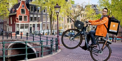 Bicycle, Vehicle, Mode of transport, Bicycle wheel, Waterway, Transport, Canal, Neighbourhood, Bicycle tire, Street fashion,