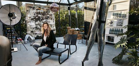 Tree, Furniture, Architecture, Interior design, Plant, Branch, Sitting, Leisure, House, Chair,