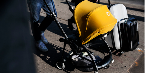 Baby carriage, Product, Baby Products, Yellow, Motor vehicle, Vehicle, Asphalt, Automotive wheel system, Wheel, Automotive tire,
