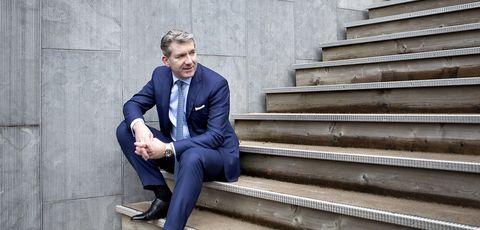 Blue, Suit, Sitting, White-collar worker, Standing, Businessperson, Formal wear, Blazer, Photography, Outerwear,