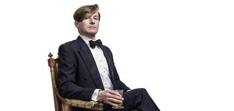 Suit, Formal wear, Tuxedo, White-collar worker, Sitting, Businessperson, Tie, Business,