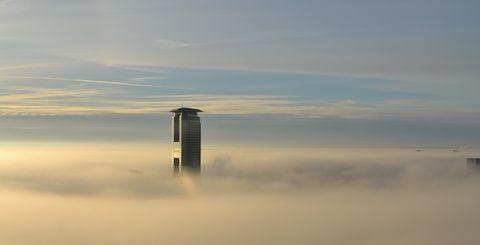 Sky, Atmospheric phenomenon, Skyscraper, Atmosphere, Morning, Calm, Cloud, Dawn, Sea, Horizon,