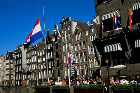 Town, Flag, Building, Waterway, City, Landmark, Human settlement, Architecture, Neighbourhood, Urban area,