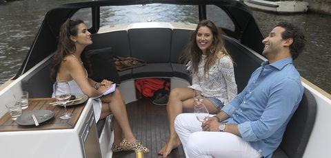 Luxury vehicle, Leg, Automotive design, Fashion, Car, Vehicle, Sitting, Thigh, Human leg, Fashion accessory,