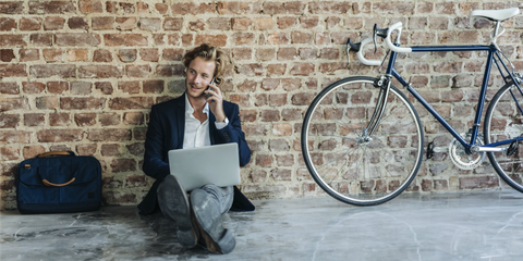 Bicycle, Water, Bicycle part, Bicycle wheel, Sitting, Businessperson, Vehicle, Bicycle tire, White-collar worker,