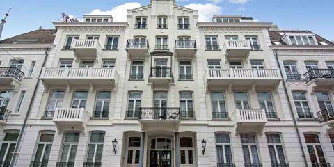 Building, Property, Apartment, Architecture, Real estate, Facade, Classical architecture, Condominium, Mixed-use, Mansion,