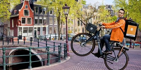 bicycle, bicycle wheel, waterway, vehicle, mode of transport, canal, transport, bicycle tire, neighbourhood, sitting,