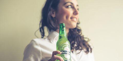 Drink, Bottle, Green, Alcohol, Alcoholic beverage, Liqueur, Distilled beverage, Black hair, Beer bottle, Glass bottle,