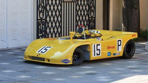 Tire, Mode of transport, Automotive design, Yellow, Vehicle, Car, Logo, Race car, Door, Sports car,
