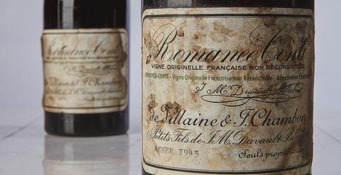 Bottle, Wine bottle, Drink, Wine, Glass bottle, Calligraphy, Alcoholic beverage, Liqueur, Label, Distilled beverage,