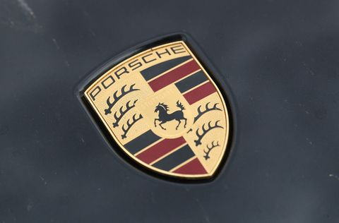 Vehicle, Emblem, Car, Logo, Badge, Porsche, Symbol, Crest, Trademark, Fashion accessory,