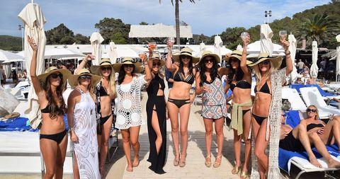 Leg, Hat, Summer, Crowd, Headgear, Thigh, Fashion accessory, Waist, Sun hat, Undergarment,