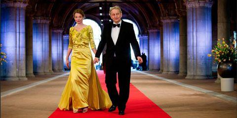 Formal wear, Fashion, Yellow, Suit, Dress, Haute couture, Event, Carpet, Gown, Fashion model,