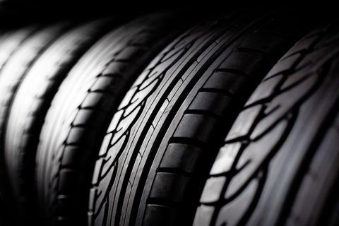 Tire, Synthetic rubber, Automotive tire, Tread, Black, Auto part, Automotive wheel system, Light, Wheel, Rim,