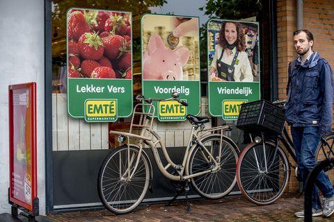 Bicycle, Advertising, Vehicle, Poster, Bicycle wheel, Display advertising, Signage, Recreation, Banner, Plant,