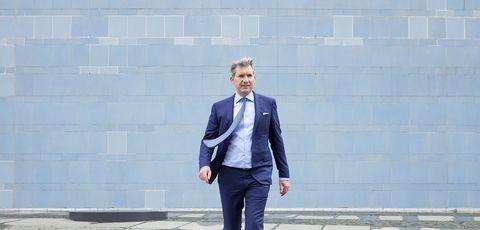 Suit, Blue, Formal wear, Blazer, Clothing, Standing, Tuxedo, Outerwear, Cobalt blue, Snapshot,