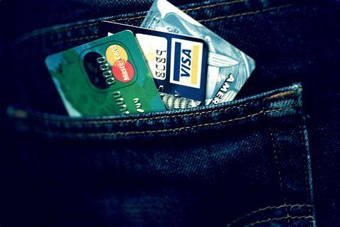 Pocket, Jeans, Denim, Wallet, Brand, Fashion accessory, Emblem,