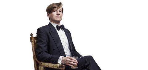 Suit, Formal wear, Tuxedo, Sitting, White-collar worker, Tie, Businessperson, Photography,