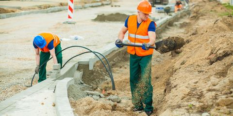 Blue-collar worker, Construction worker, Personal protective equipment, Soil, Geological phenomenon, Sanitary sewer, Hard hat, Public utility,