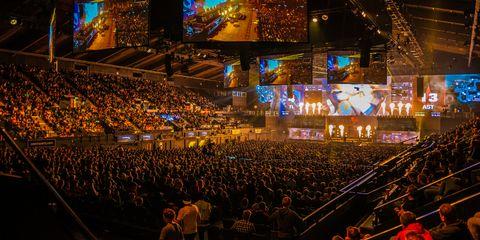Crowd, Audience, People, Stage, Event, Fan, Convention, Auditorium, Sport venue, Performance,