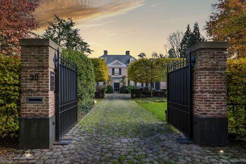 Property, Sky, House, Tree, Home, Building, Cobblestone, Estate, Residential area, Gate,