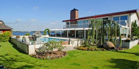 Property, House, Building, Real estate, Home, Architecture, Eco hotel, Grass, Villa, Facade,