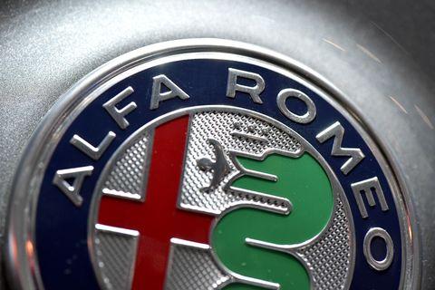 Motor vehicle, Logo, Trademark, Vehicle, Car, Emblem, Wheel, Font, Auto part, Automotive wheel system,