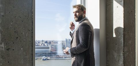 Facial hair, Beard, Standing, Urban area, Outerwear, Photography, Window, Architecture, Suit, White-collar worker,