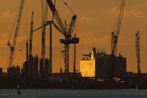 Industry, Crane, Sky, Jackup rig, Yellow, Vehicle, Water, City, Evening, Urban area,