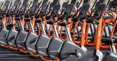 exercise equipment, exercise machine, elliptical trainer, sports equipment, room, golf equipment, golf club, iron, sport venue, physical fitness,