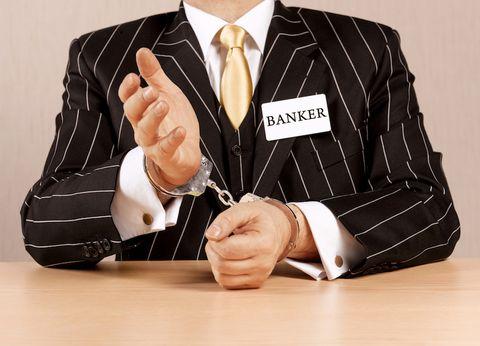 Suit, Formal wear, Finger, White-collar worker, Businessperson, Hand, Sitting, Tie, Thumb, Tuxedo,