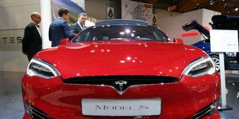 Land vehicle, Vehicle, Car, Motor vehicle, Auto show, Automotive design, Performance car, Grille, Automotive exterior, Tesla model s,
