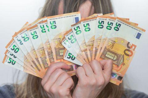 Money, Cash, Currency, Banknote, Hand fan, Money handling, Hand, Money changer, Saving, Paper,