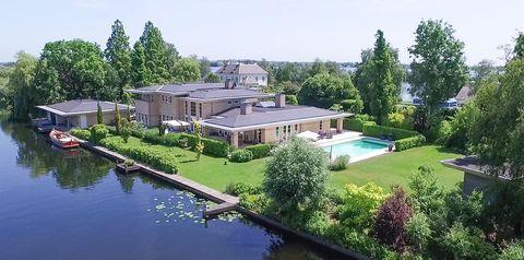Property, Home, Estate, House, Natural landscape, Real estate, Waterway, Building, Mansion, Villa,