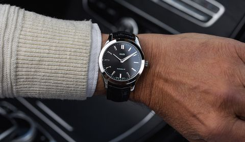 Analog watch, Watch, Watch accessory, Wrist, Strap, Fashion accessory, Material property, Hand, Jewellery, Font,