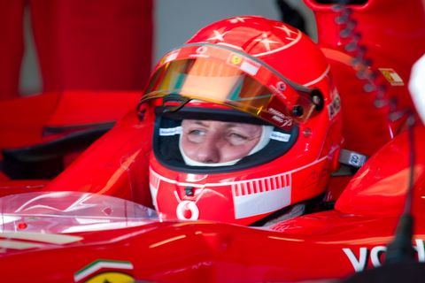 Helmet, Race car, Red, Vehicle, Formula racing, Personal protective equipment, Car, Formula one, Open-wheel car, Sports,