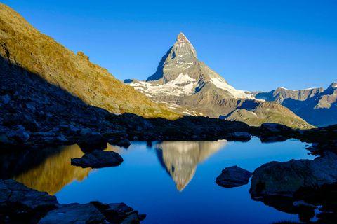 Mountain, Reflection, Mountainous landforms, Nature, Natural landscape, Sky, Mountain range, Tarn, Wilderness, Blue,