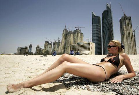 Human leg, Tower block, Summer, Sun tanning, Toe, Thigh, Undergarment, Skyscraper, Sunglasses, Vacation,